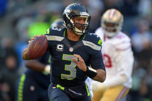 Russell Wilson a accumulé 1000 verges au cours... (PHOTO KIRBY LEE, ARCHIVES USA TODAY)