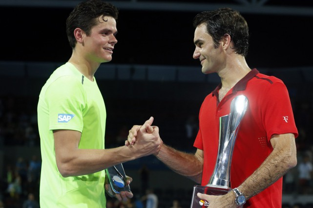 Milos Raonic et Roger Federer... (Photo Jason Reed, Reuters)