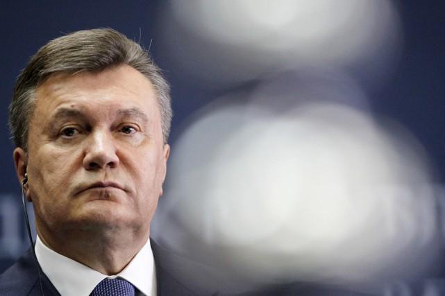 L'ancien président Ianoukovitch est recherché pour des malversations... (PHOTO DARKO VOJINOVIC, ARCHIVES AP)
