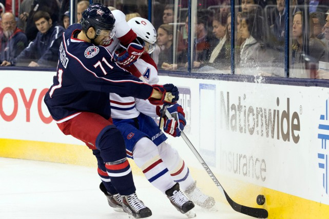 Nick Foligno et Andrei Markov... (Photo archives USA Today Sports)