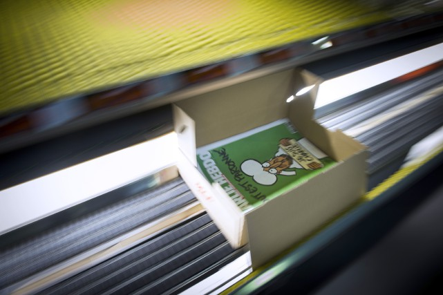 L'édition de mercredi du Charlie Hebdo... (Photo MARTIN BUREAU, AFP)