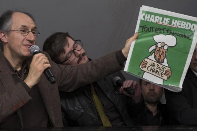 Le dessinateur Luz (à droite), auteur de la... (PHOTO REUTERS)