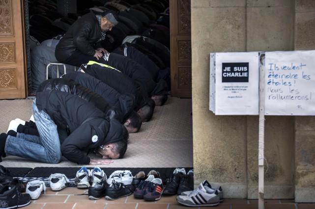 Depuis le 11-Septembre, les musulmans sont quotidiennement diabolisés... (Photo JEAN-PHILIPPE KSIAZEK, Agence France-Presse)
