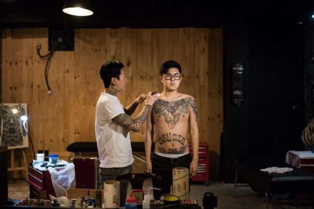 «Si on veut un tatouage, on doit aller... (Photo Ed Jones, AFP)