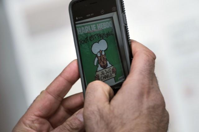 Pour pallier les ruptures de stock et favoriser les abonnements, Charlie... (Photo BRENDAN SMIALOWSKI, AFP)