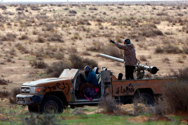 De combattants de Fajr Libya.... (PHOTO MAHMUD TURKIA, ARCHIVES AGENCE FRANCE-PRESSE)