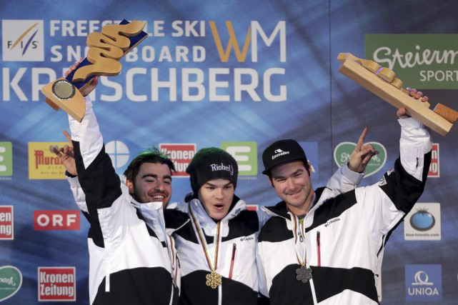 Les bosseurs québécois Philippe Marquis, Mikaël Kingsbury et... (PHOTO LISI NIESNER, AFP)