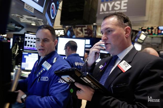 Wall Street était en très légère baisse mardi à la mi-journée, le marché... (Photo Richard Drew, AP)