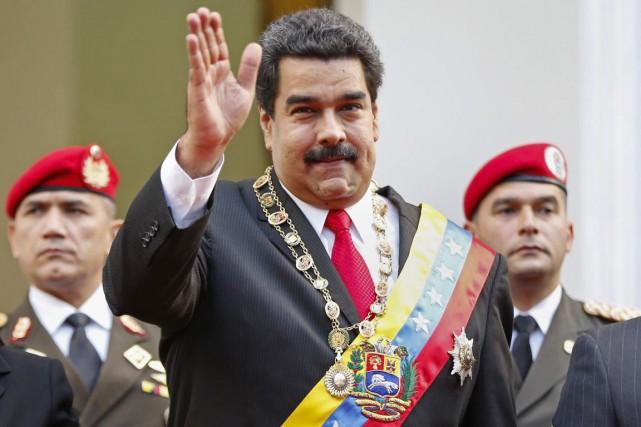 Le président Nicolas Maduro, élu de justesse en... (PHOTO CARLOS GARCIA RAWLIN, ARCHIVES REUTERS)