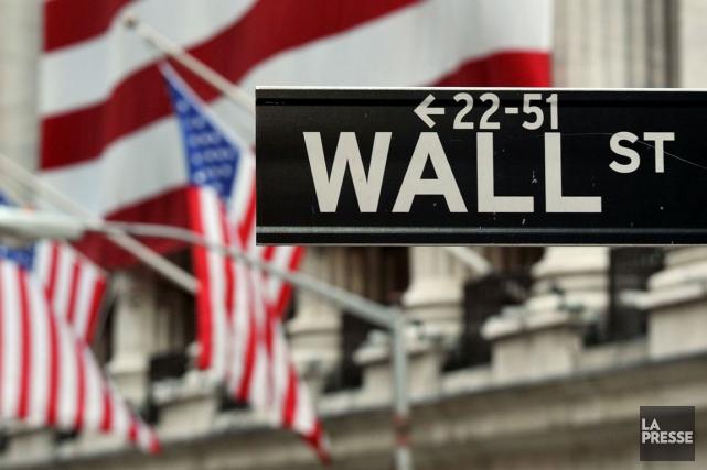 La Bourse de New York a terminé en nette hausse hier, continuant à se réjouir... (Photo Archives AFP)