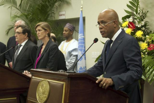 Prenant la parole au cours de la conférence... (PHOTO HECTOR RETAMAL, AFP)