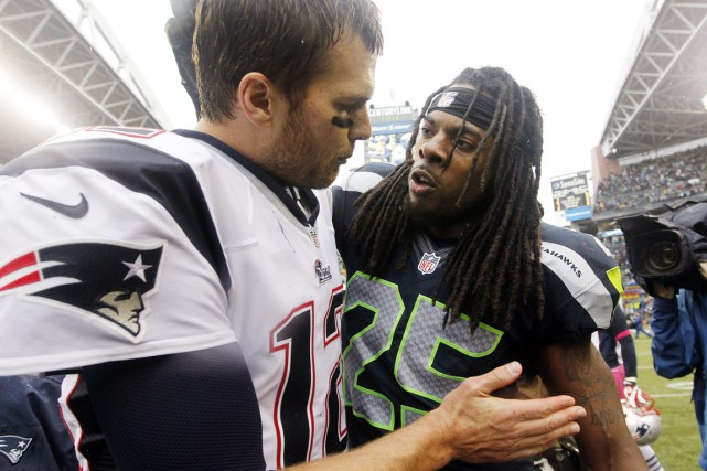 Tom Brady et Richard Sherman, après le match... (Photo Elaine Thompson, archives Associated Press)
