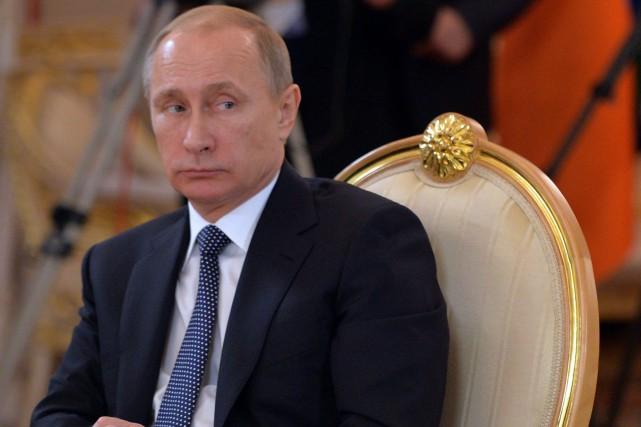 Le président russe Vladimir Poutine... (Photo AP/Gouvernement russe)