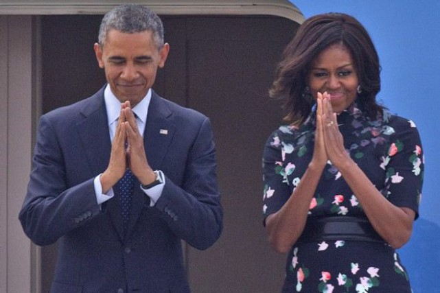 Barack et Michelle Obama... (PHOTO MANISH SWARUP, ASSOCIATED PRESS)