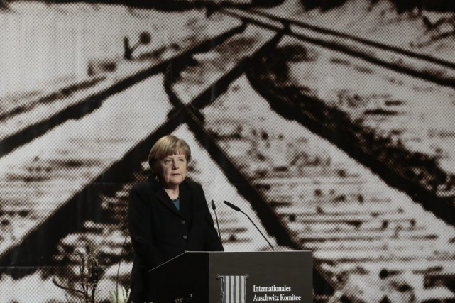 Contrairement à la chancelière allemande AngelaMerkel(photo), le président... (PHOTO MARKUS SCHREIBER, ASSOCIATED PRESS)