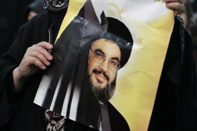 Des partisans du chef du Hezbollah Hassan Nasrallah,... (Photo Bilal Hussein, AP)