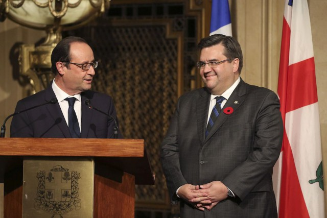Denis Coderre et Francois Hollande à l'hôtel de ville de Montréal,... (Photo Christinne Muschi, Archives REUTERS)
