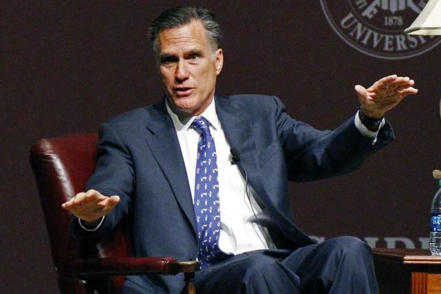 Mitt Romney a annoncer vendredi à ses partisans... (Photo Rogelio V. Solis, AP)