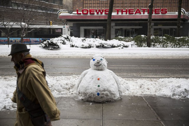 Environ 15 cm de neige sont tombés sur Manhattan,... (PHOTO DAMON WINTER, THE NEW YORK TIMES)