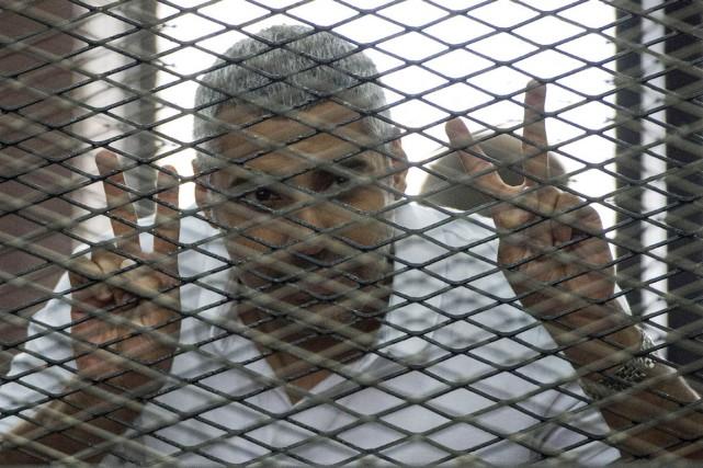 Arrêté en décembre 2013 avec ses deux confrères,... (PHOTO KHALED DESOUKI, ARCHIVES AFP)
