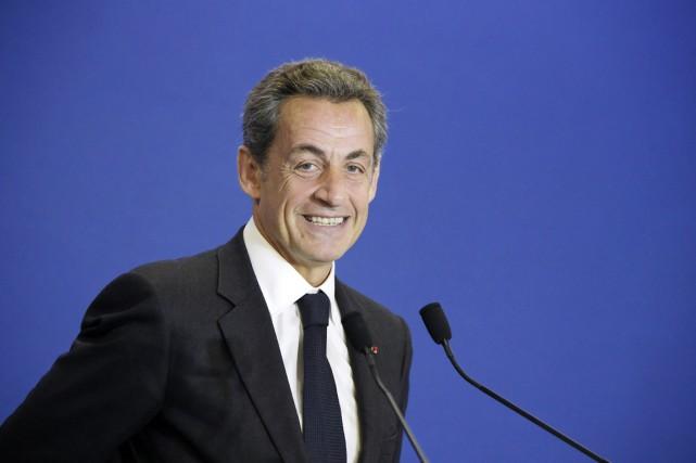 Nicolas Sarkozy sourit lors d'un rassemblement de l'UMP,... (PHOTO LIONEL BONAVENTURE, ARCHIVES AFP)