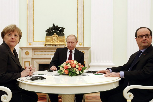 François Hollande, Angela Merkel et Vladimir Poutine (au... (Photo Maxim Zmeyev, Reuters)