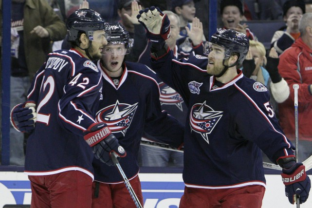 Ryan Johansen (au centre), célèbre avec ses équipiers... (Photo Jay LaPrete, AP)