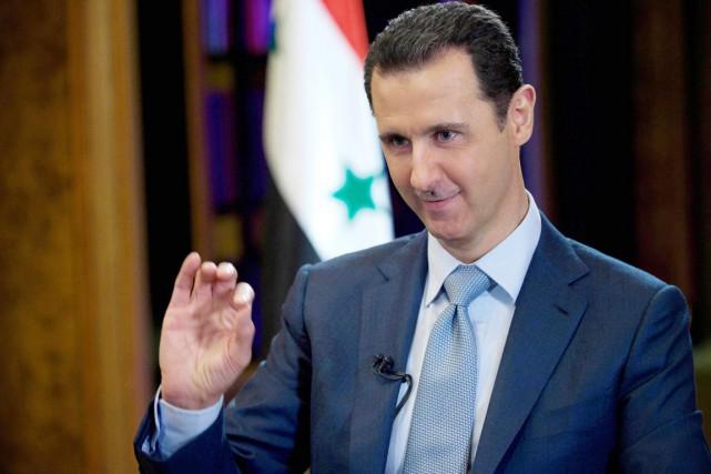 Le président syrien, qui s'exprimait en anglais, a... (PHOTO AP/SANA)
