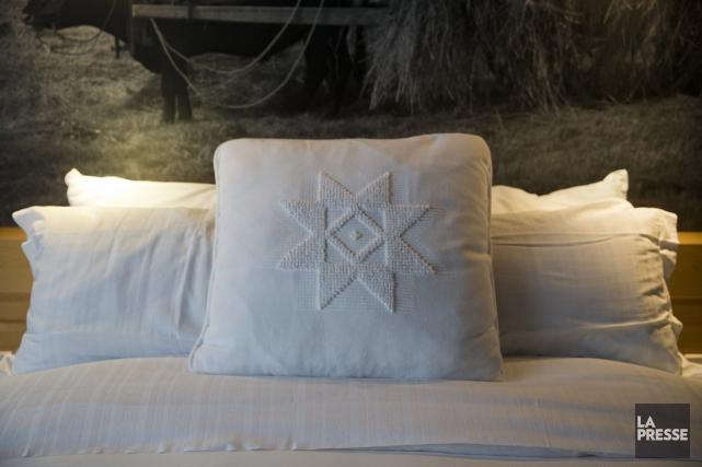 Un coussin orné de l'étoile de Charlevoix, réalisé... (PHOTO FRANCOIS ROY, LA PRESSE)