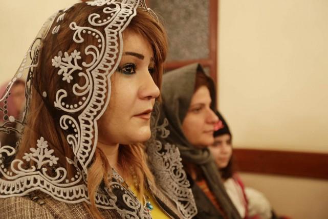 Des chrétiens assyriens d'Irak, de Syrie et du... (PHOTO ANWAR AMRO, ARCHIVES AFP)