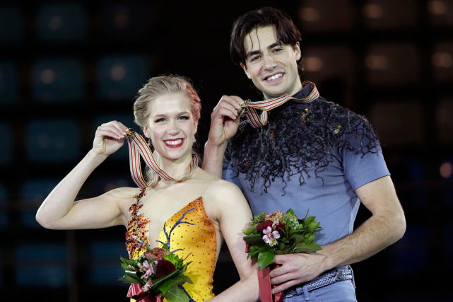 Kaitlyn Weaver et Andrew Poje... (Photo Lee Jin-man, AP)