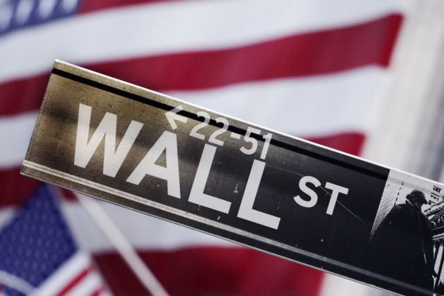 Wall Street a fini en légère hausse mardi, se montrant attentiste à la veille... (Photo Mark Lennihan, AP)