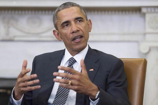 Le veto d'Obama renvoie la balle au Congrès.... (PHOTO AFP, JIM WATSON)
