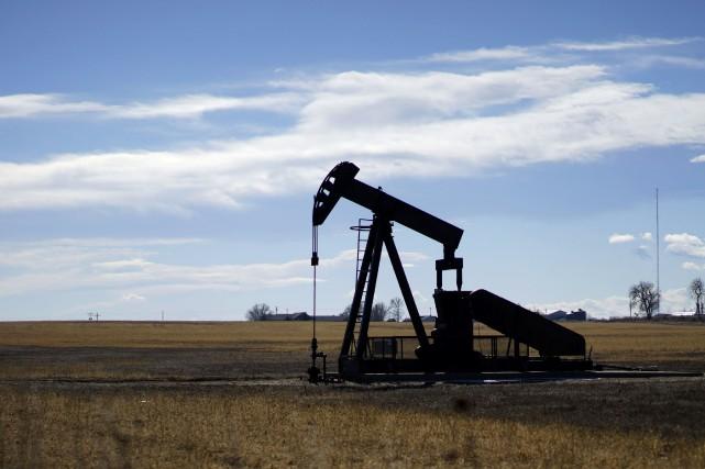Les prix du pétrole ont baissé à New York et stagné à Londres vendredi, le... (Photo Rick Wilking, Reuters)
