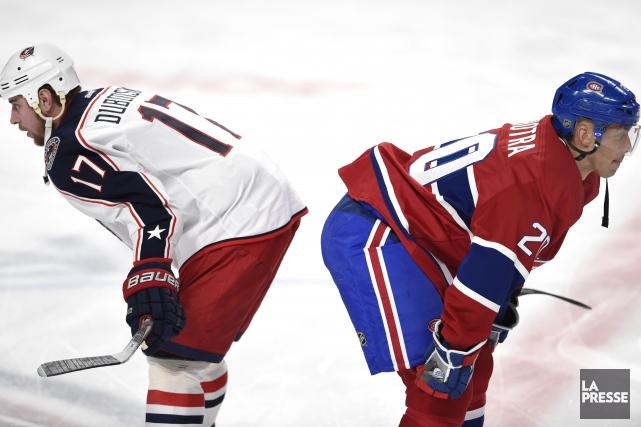 Brandon Dubinsky et l'attaquant du Canadien Manny Malhotra... (PHOTO BERNARD BRAULT, LA PRESSE)