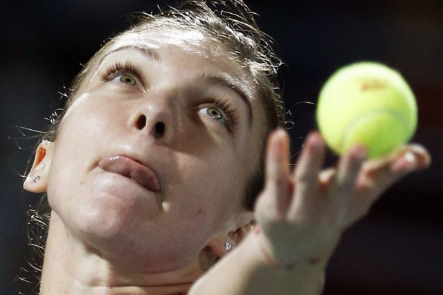Simona Halep... (PHOTO AHMED JADALLAH, REUTERS)
