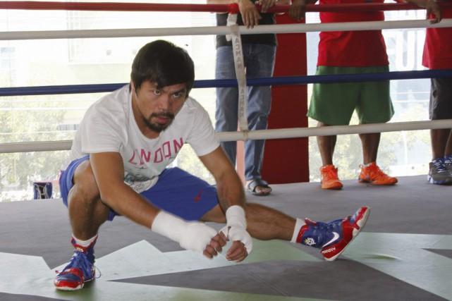 Manny Pacquaio s'entraîne en vue deson combat du... (PHOTO AGENCE FRANCE-PRESSE)