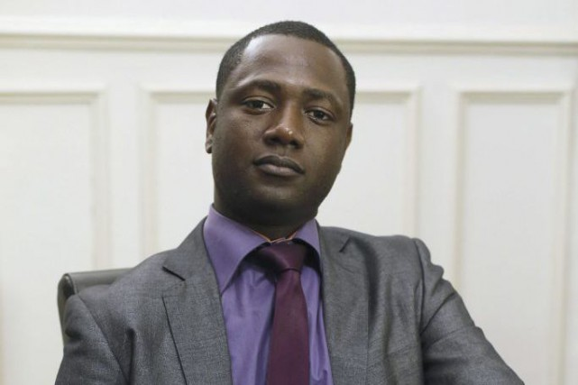 Souleymane Sylla s'est vuempêché de monter à bord... (PHOTO PATRICK KOVARIK, AFP)