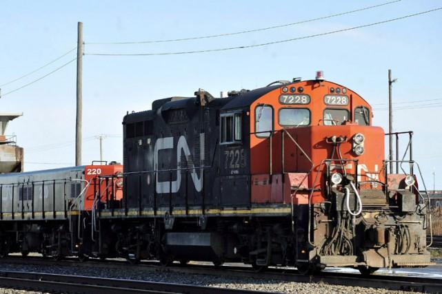 Le Canadien National (T.CNR)et Unifor se sont entendus, tard... (Photo: PC)