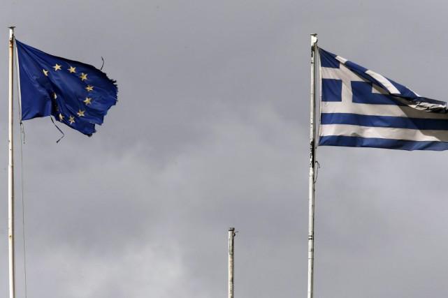 La liste de réformes de la Grèce est... (PHOTO YANNIS BEHRAKIS, REUTERS)