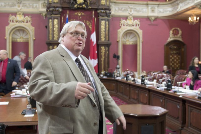 Le ministre Gaétan Barrette.... (PHOTO JACQUES BOISSINOT, LA PRESSE CANADIENNE)