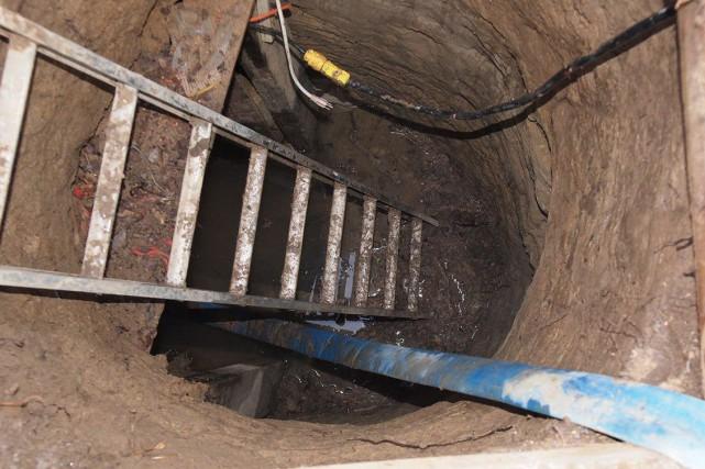 L'entrée du tunnel découvert près du Rexall Centre.... (PHOTO LA PRESSE CANADIENNE/POLICE DE TORONTO)
