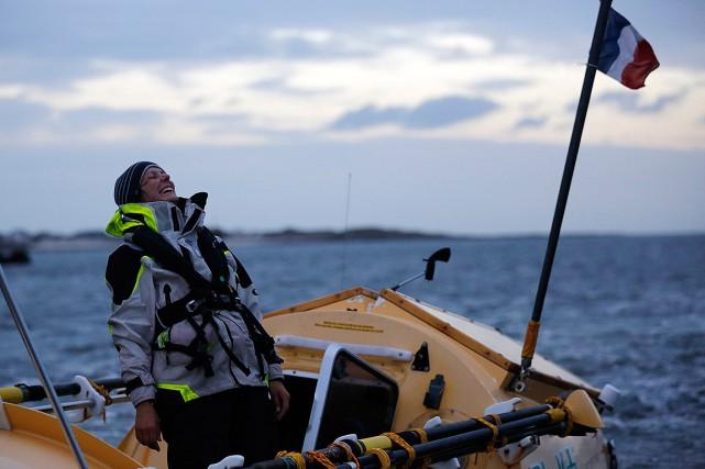 La rameuse Mylène Paquette, triomphante à la fin... (PHOTO STEPHANE MAHE, REUTERS)