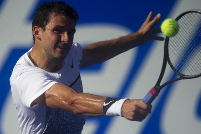 Le Bulgare Grigor Dimitrov a étééliminé par l'Américain... (Photo Pedro Pardo, AFP)