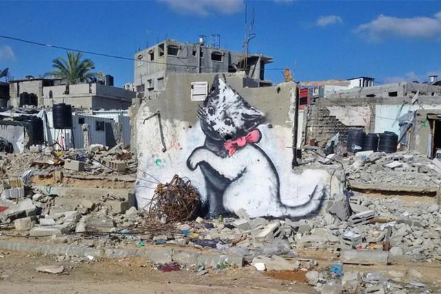 Un chat peint par Banksy sur un morceau... (PHOTO DR)
