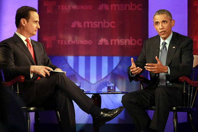 Le président Barack Obama (à droite) participe à... (PHOTO PEDRO PORTAL, AP/EL NUEVO HERALD)