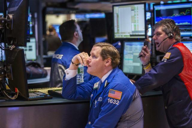 Wall Street a fini jeudi en ordre dispersé, une chute des cours du pétrole et... (PHOTO LUCAS JACKSON, REUTERS)