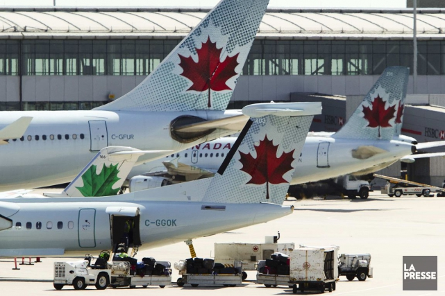 Air Canada (T.AC) a déposé une demande de conciliation auprès... (PHOTO MARK BLINCH, ARCHIVES REUTERS)