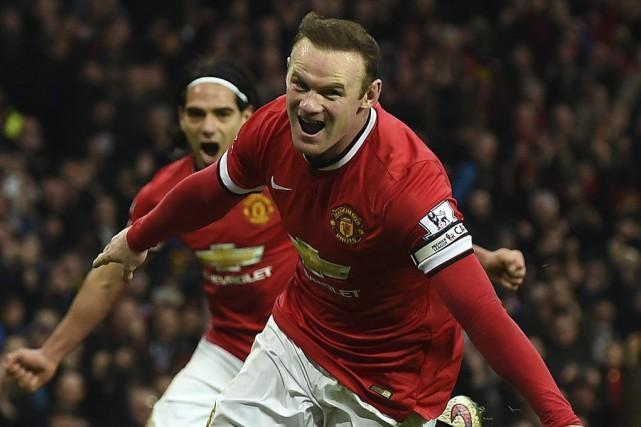 Wayne Rooney aconverti un penaltyprovoqué parRadamel Falcao.... (PHOTO PAUL ELLIS, AFP)