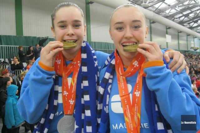 Les quatre médailles amassées par Valérie Pelletier et... (Photo: Vincent Gauthier, Le Nouvelliste)